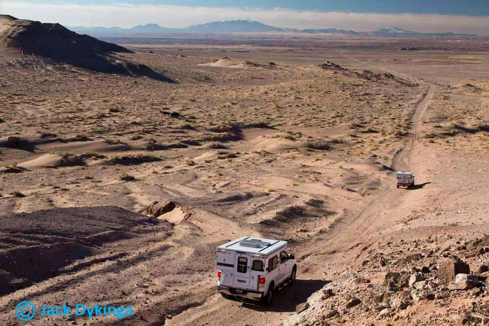 jack-dykinga-processing-film-inside-fleet-model-camper-camping-desert